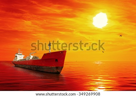 Silhouette of the tanker ship on red sunrise. - stock photo