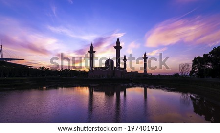 Silhouette of the Tengku Ampuan Jemaah Mosque, Bukit Jelutong, Malaysia mosque at sunrise. - stock photo