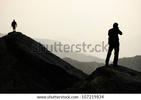 Silhouette of the tourist - stock photo