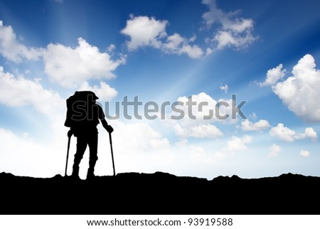 Silhouette of the tourist on background bright sky. Active life