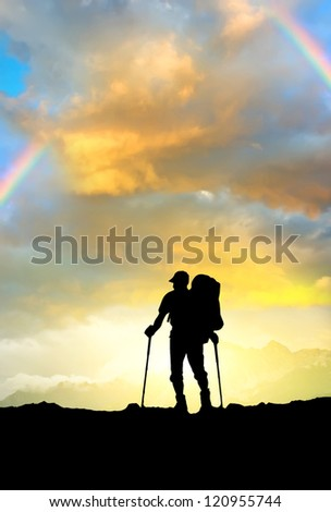 Silhouette of the tourist on mountain plain. Concept and idea