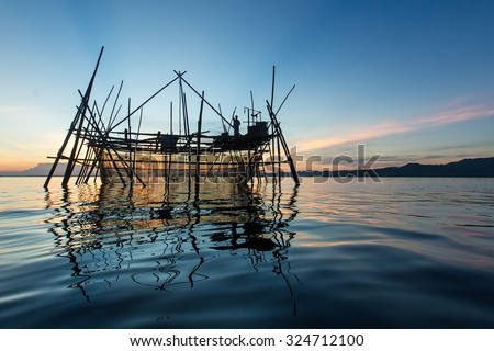 Silhouette of the traditional fishing structure built with bamboo called Bagang, typical of Sabah, Borneo.