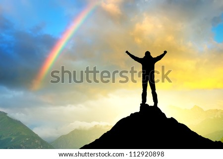 Silhouette of the winner on background of sundown. Sport and active life - stock photo