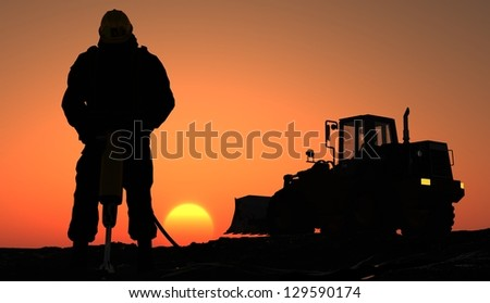 Silhouette of the worker and tractor. - stock photo