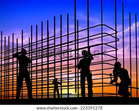 Silhouette of the workers on a background of the sky   - stock photo