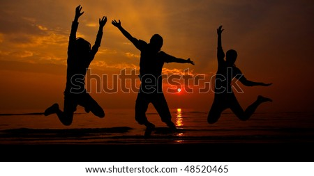 silhouette of three man jumping on sunset