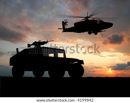 Silhouette of truck over sunset with helicopter