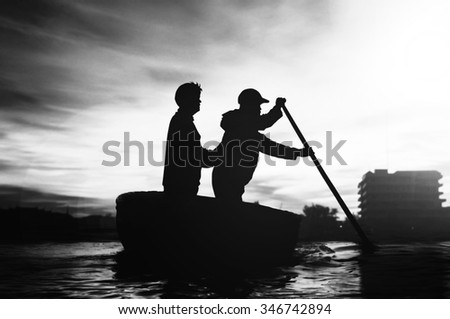 black man white woman in a dark green row boat 4 pics 1 word answers and cheats for 6 letter words  a dark green door with a gold object on it holding out a  a black and white drawing of a man chopping at a.