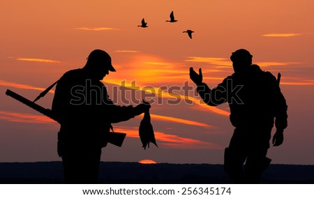 Silhouette of two mens on the hunting - stock photo