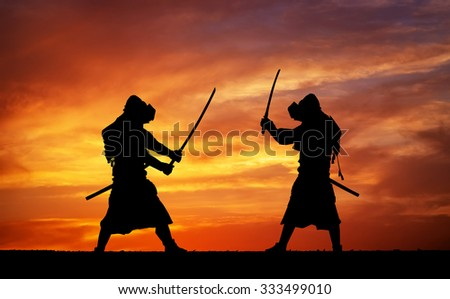 Silhouette of two samurais in duel. Picture with two samurais and sunset sky - stock photo