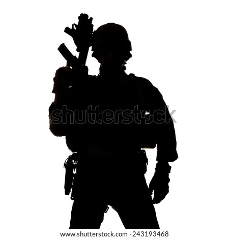 Silhouette of United States Army ranger with assault rifle - stock photo