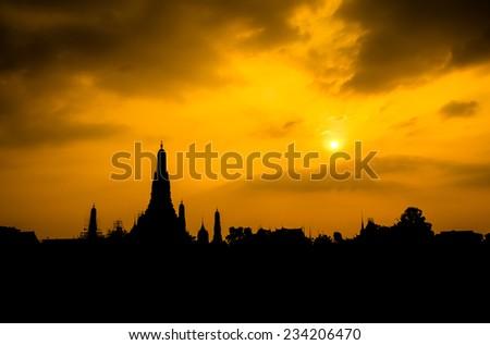 Silhouette of Wat Arun shot from across Chaopraya river - stock photo