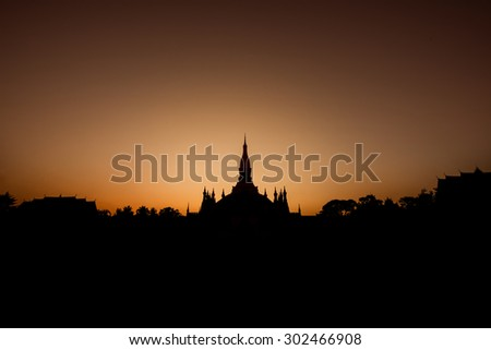 Silhouette of Wat Phra That Luang, Vientiane, Lao PDR - stock photo