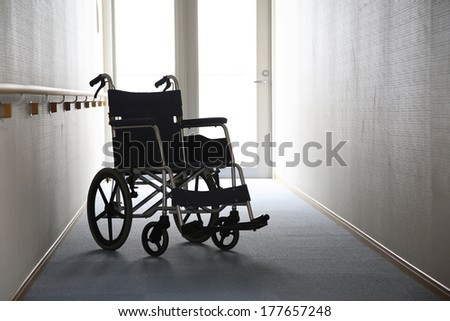 Silhouette of wheelchair
