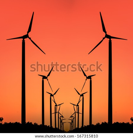 Silhouette of wind turbine  - stock photo