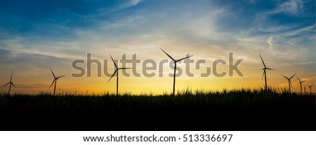 Silhouette of wind turbine site on sunset background