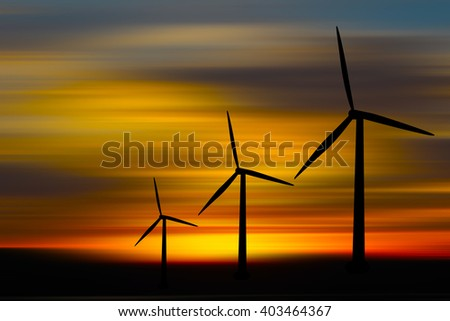 Silhouette of windmill with natural background, at sunset time.