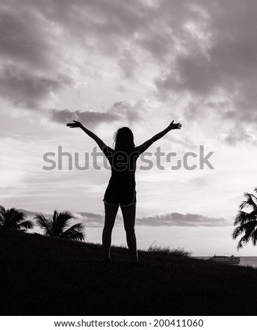 Silhouette of woman enjoying nature. Freedom concept. Enjoyment. - stock photo
