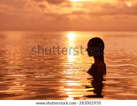 Silhouette of woman in the water.