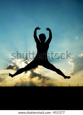 Silhouette of Woman Jumping for Joy - stock photo