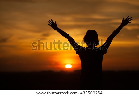 Silhouette of woman  on sunset