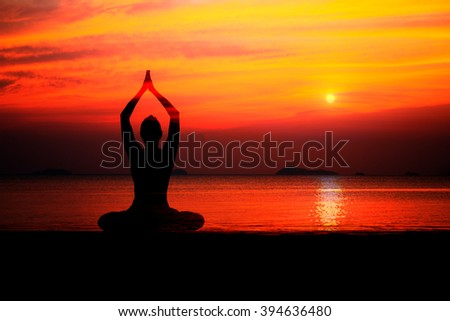 Silhouette of woman on the background of the stunning sea and sunset making yoga poses, spirit exercises, computer art