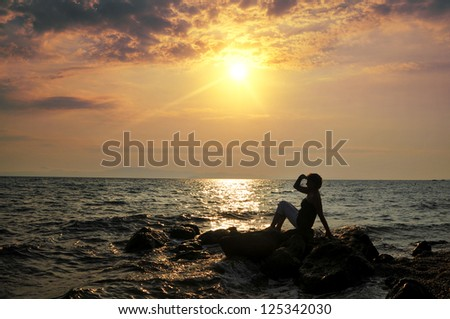 Silhouette of woman on the sea
