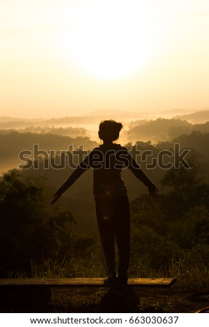 Silhouette of woman  over beautiful sky background,freedom women