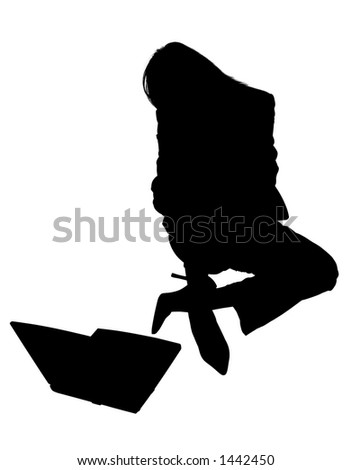 Silhouette of woman sitting with laptop.