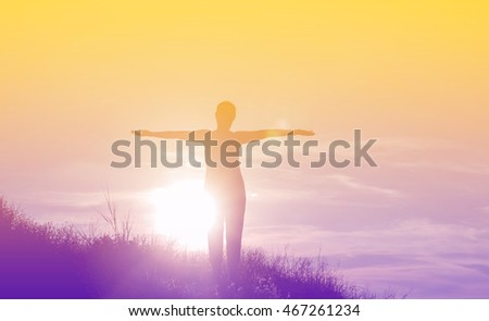 Silhouette of woman So happy at sunset