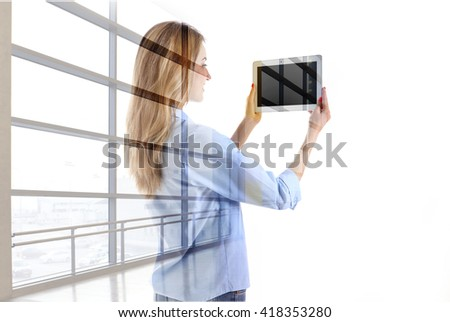 Silhouette of woman with tablet pc and overlaid big city, isolated on white. Global Communications concept - stock photo