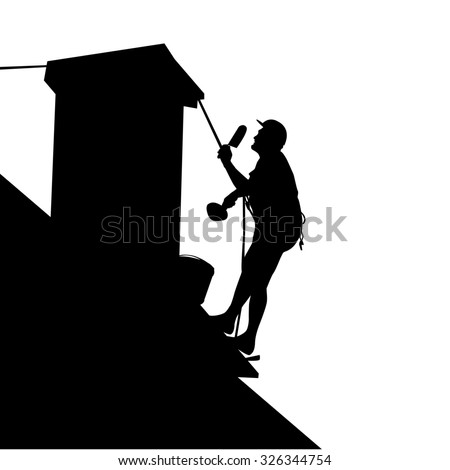 Silhouette of worker on the house roof - stock photo