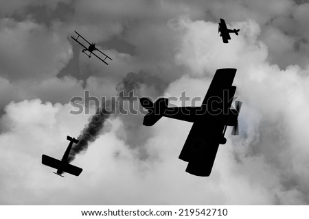 Silhouette  of World War One Aircraft in a dogfight over the battlefields of Europe. British vs Germans. (Computer Art) - stock photo