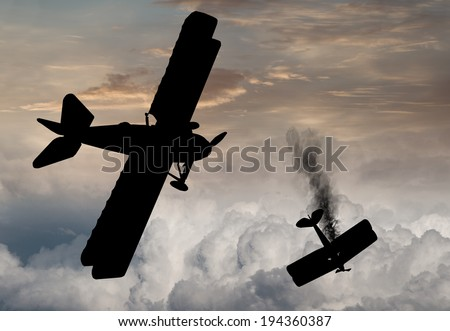 Silhouette of World War One Bi-planes and Tri-planes engaged in a dogfight. (Artist's impression)