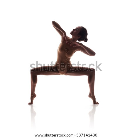 silhouette of young beautiful dancer in beige swimsuit isolated on white studio background - stock photo