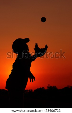 Silhouette of Young Boy Playing Baseball - stock photo