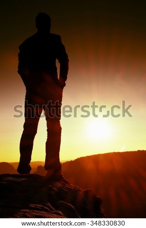 Silhouette of Young Confident and Powerful Man Standing with Hands on Hips, Late Day Sun with Copy Space