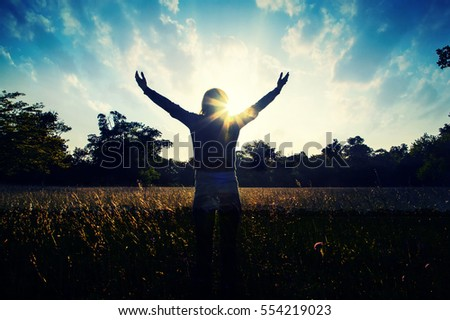 silhouette of young girl with hands open in forest.nature lover, spirit of forest