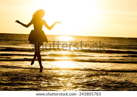silhouette of young happy woman on water background, outdoor portrait, summer vacations