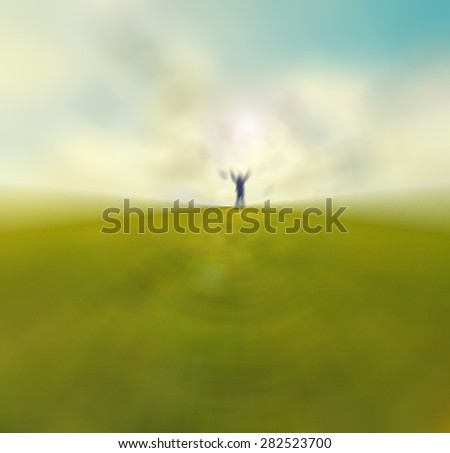 Silhouette of young man standing with hands open wide on the top of green field under sunset skies ,freedom , success and freedom concept - stock photo