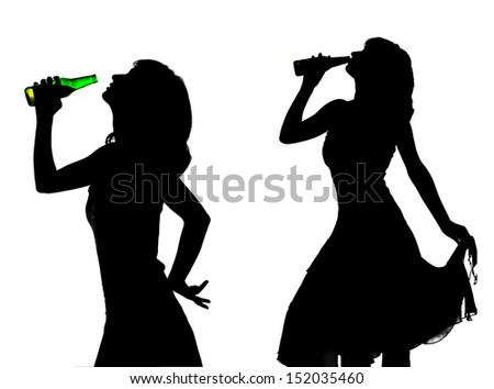 silhouette of young woman with beer - stock photo