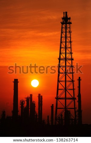 Silhouette oil refinery at sunrise - stock photo