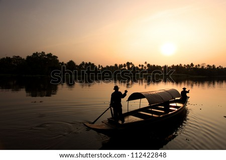 silhouette old boat and oarsman in Thailand.
