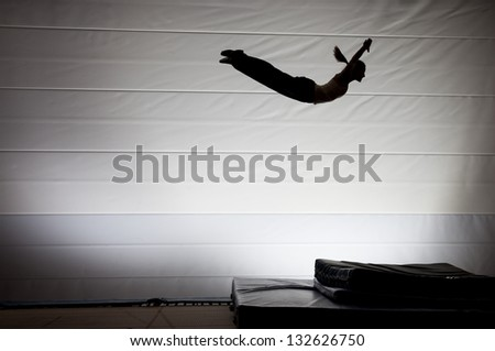 silhouette on trampoline - stock photo