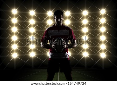 Silhouette os a Rugby player in a red uniform. White Background - stock photo