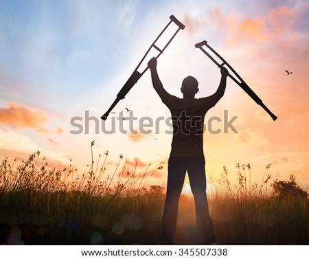 Silhouette people disabled man stand up. Handicapped Disability Recovery Healing Helper Health Care Insurance Agent Sick Fulfillment Final Decision He Is Risen Easter Sunday Resurrection concept. - stock photo