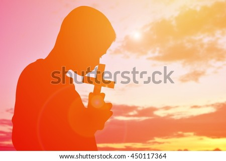 Silhouette people jesus and cross at sunset - stock photo
