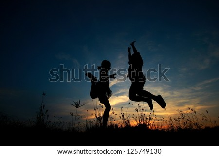 Silhouette people jumping. - stock photo