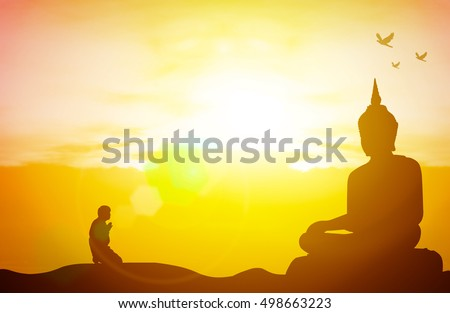 Silhouette people pray from buddha statue to hope for help on sun set and bokeh background. Inspiration from help to hope, Vesak Day, Wesak, Jayanti, Visak Bohea, Visakha Bucha, Buddha Purnima concept