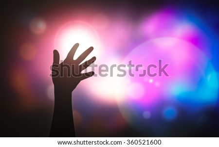 Silhouette people raising hands on blurred colorful light background. Forgiveness, Mercy, Evangelical, Hallelujah, Redeemer, Amen, Human Rights, Love, Happy Valentine Day, Autism, Awareness concept - stock photo